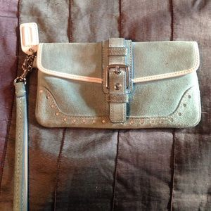 Coach light blue suede wristlet with white eyelet