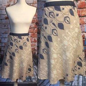 Old Navy Beige A-line skirt with peacock design