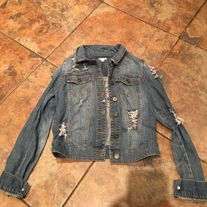 Custom made distressed denim jacket