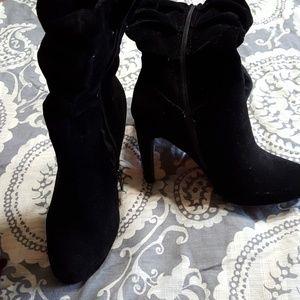 Black knee high, high heel velvet boots