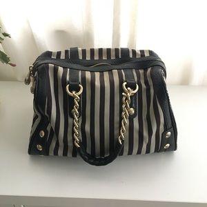 Henri Bendel black striped barrel handbag