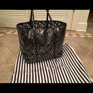 Henri Bendel clear bag with black flower insert