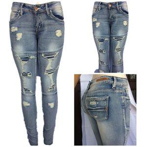 Women light wash distressed skinny jeans Nwt