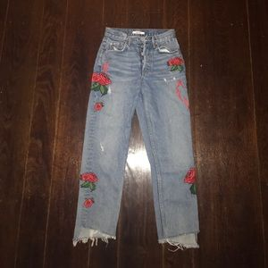 Blue jeans with floral embroidery