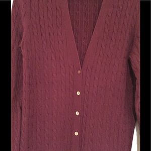 Deep wine colored cable knit cardigan.