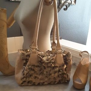Gorgeous tan leather bag with metal detailing