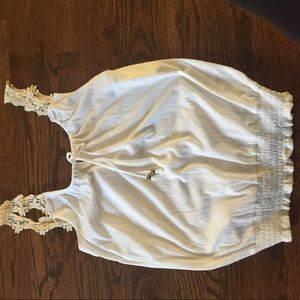 White cotton tank with lace straps.