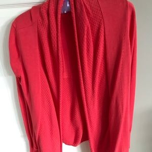 Orange light sweater with knit embellishments