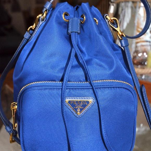 93a1e96452c M 5a09f2bf9c6fcf33e917b196. Other Bags you may like. Prada Striped Canvas  Leather Crossbody Tote Blue. Prada Striped Canvas Leather Crossbody Tote  Blue