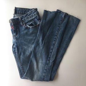 Unfinished hem jeans.
