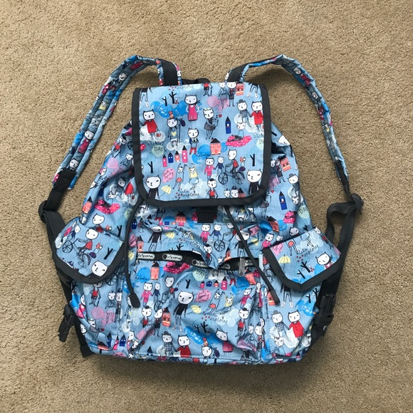 28b456eb7 Lesportsac Handbags - SOLD Lesportsac cartoon cat Voyager backpack