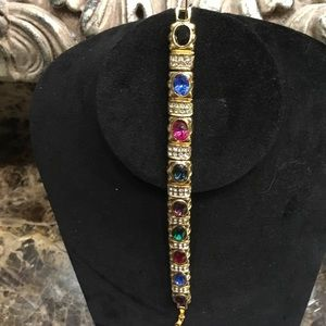 """Jewelry - 7"""" multicolored stones in a gold tone bracelet"""