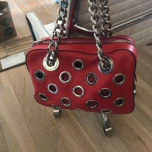 Prada leather grommet bag with  chain in red.