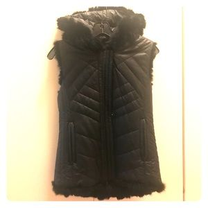Reversible fur and faux leather vest.