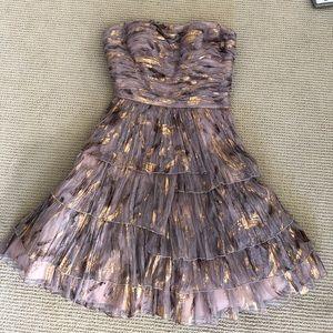 Aidan Mattox gold strapless dress.