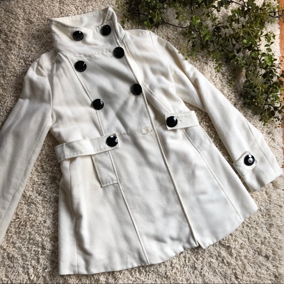 White pea coat with black buttons