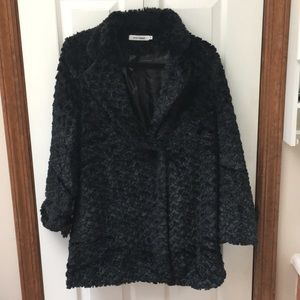 Black faux fur jacket.