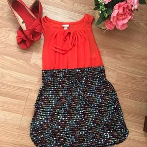 Red blouse with abstract skirt