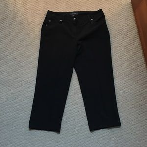Black cropped dress pants with cuff at bottom.