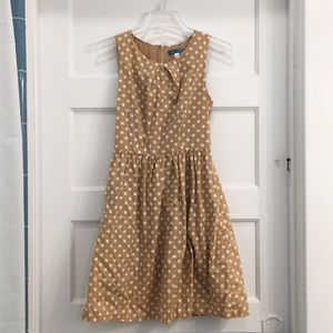 Old fashioned tan and white polka dot dress