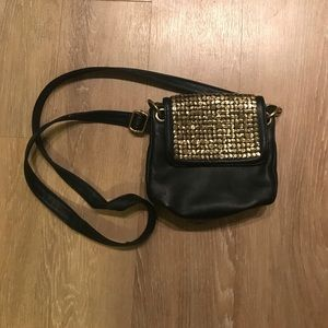 Ecote hammered gold and black leather bag