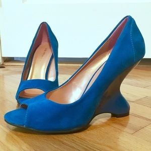 Vibrant blue wedge heels.  Never worn.  Size 7