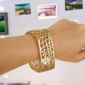 New Boxed Jewelmint Bird Cage bangle bracelet GOLD