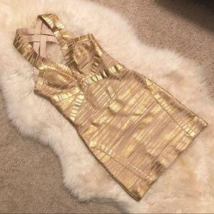 BEBE women's cream w/ metallic gold bandage dress