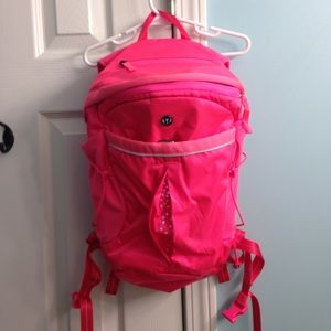 Lululemon run all day backpack in neon pink.