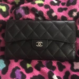 Quilted black Chanel leather pouch.