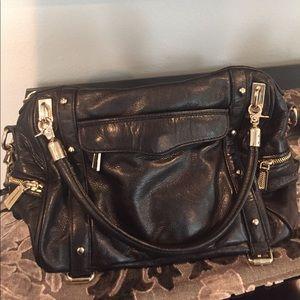 Black and gold Rebecca Minkoff handbag