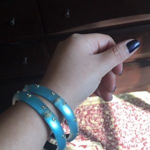 2 light blue Alexis bitter bracelets .