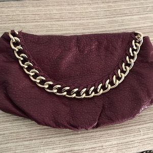 Burgundy clutch leather bag with gold chain detail