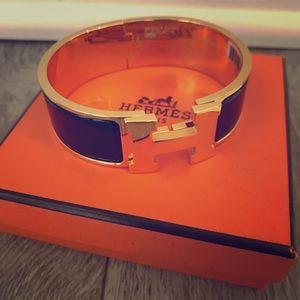 Hermès black x gold clic clac bracelet (unisex)