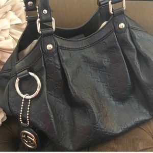 Authentic Gucci leather sukey in black
