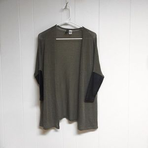 Army green cardigan with leather sleeves.