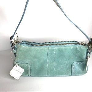 Coach blue suede handbag.
