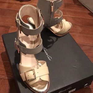 Kenneth Cole buckle/strappy open toe and back heel