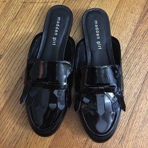 Black loafer like shoes