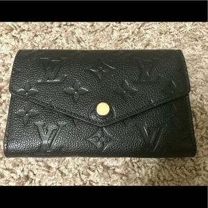 LOUIS VUITTON: Compact Curieuse Wallet— Empreinte
