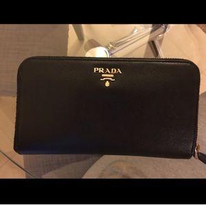 Prada saffiano leather zippy wallet with box