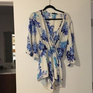 Dresses & Skirts - Blue floral romper size small