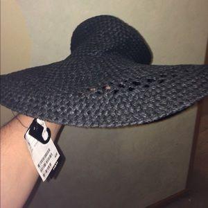 Black floppy hat.