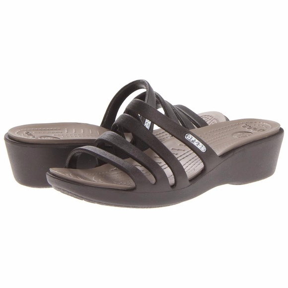 e11a1193e58d Crocs Women s Rhonda Wedge Sandal Sandals size 9. M 5a0f1363bf6df56fa9036c9a