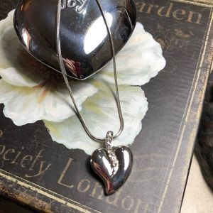 Silver heart with rhinestone necklace.