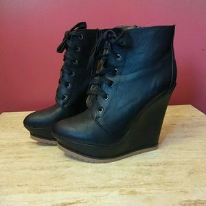 Black wedge closed toe boots