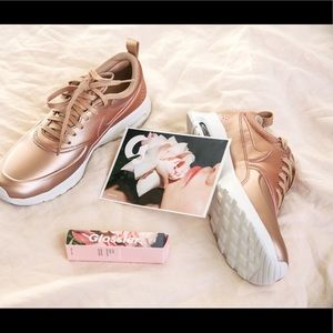 Rose gold Nike: barely worn!