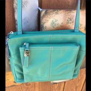 Tignanello cross body bag. Lots of storage. Aqua