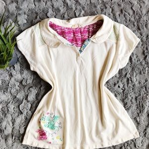 Anthropologie embroidered cream polo shirt
