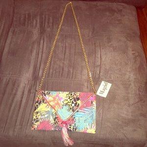 "Beautiful Caribbean print bag. 25"" gold chain."